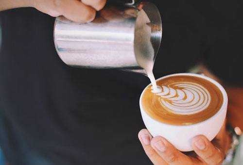 creating latte with commercial machine