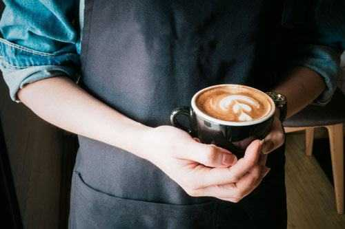 coffee barista holding coffee
