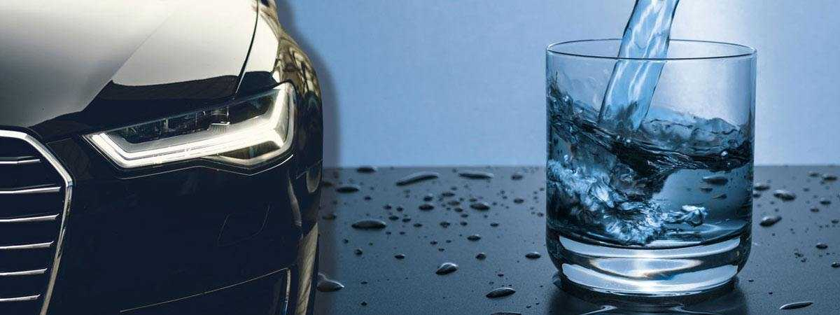 car next to a glass of water