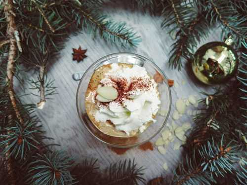 festive latte with cream and almonds