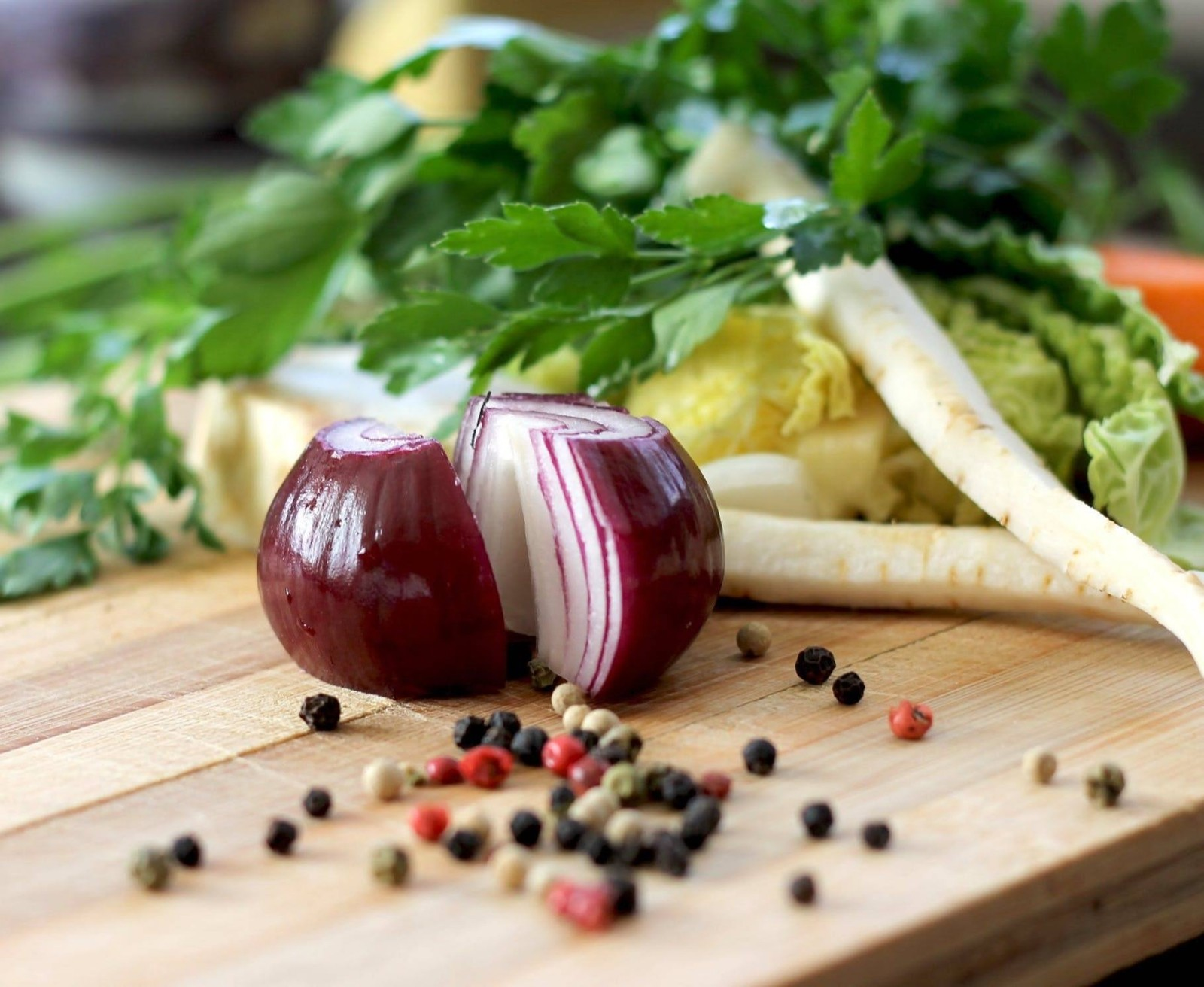 Onions and vegetables on chopping board