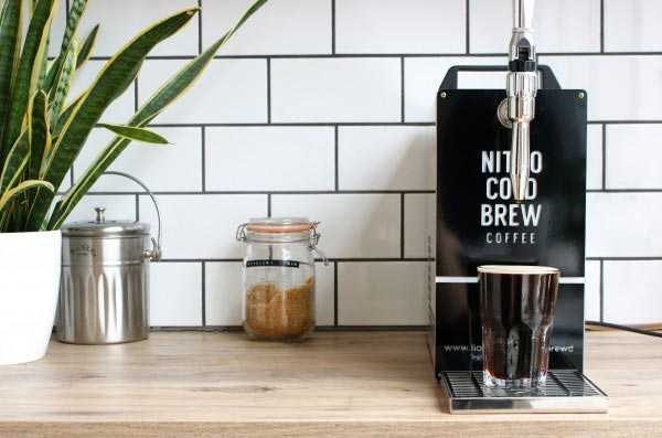nitro cold brew coffee machine in front of wall