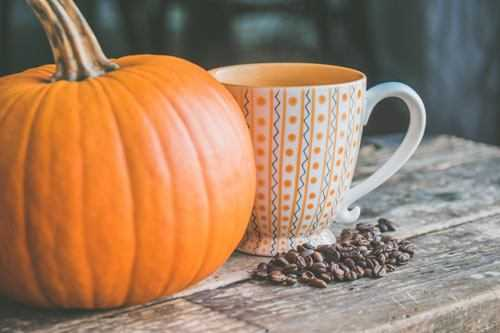 pumpkin coffee beans and cup