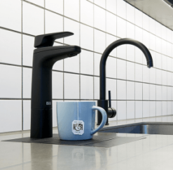 Two billi taps next to a sink, one making a cup of tea