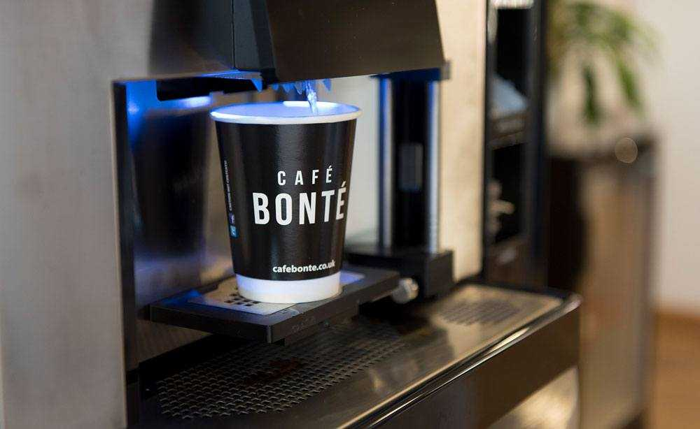 commercial coffee dispenser in use