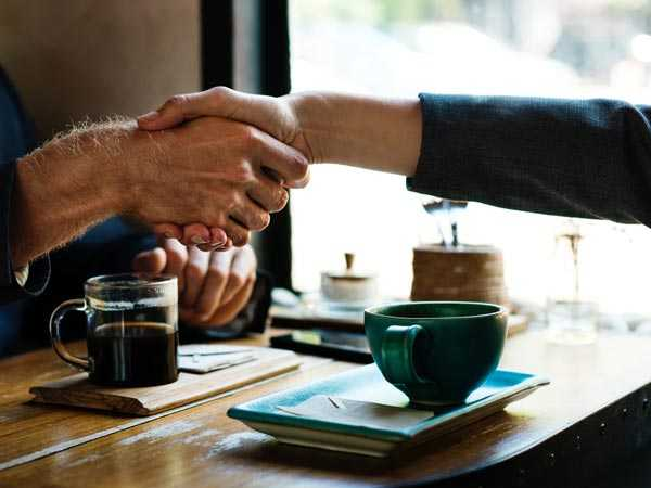 handshake over coffee