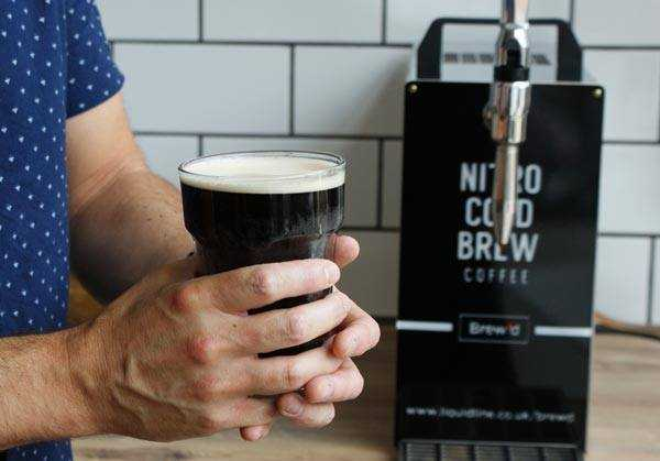 man holding a nitro cold brew pint