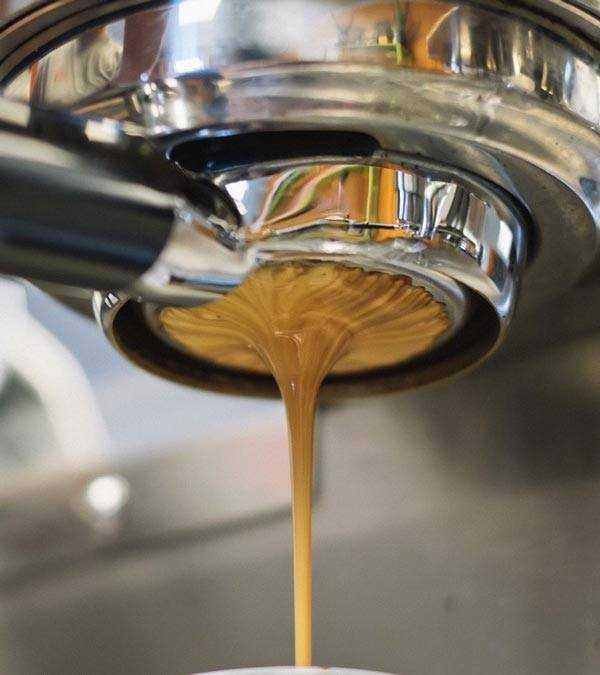 professional espresso machine pouring coffee