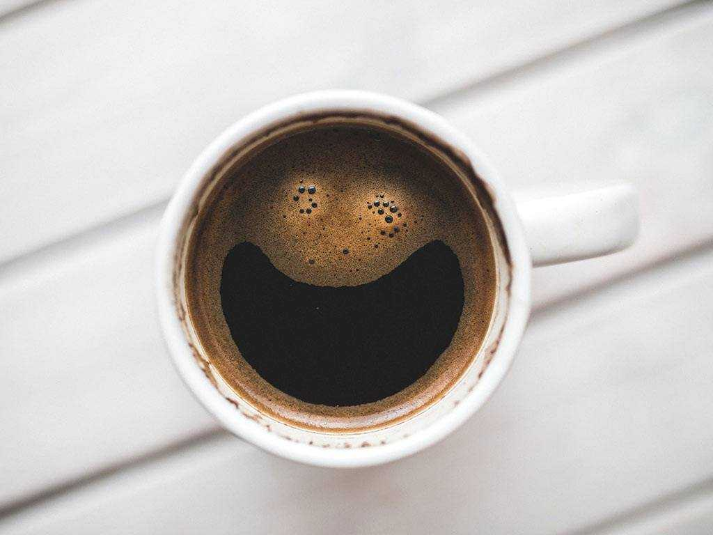 smile made out of crema on coffee