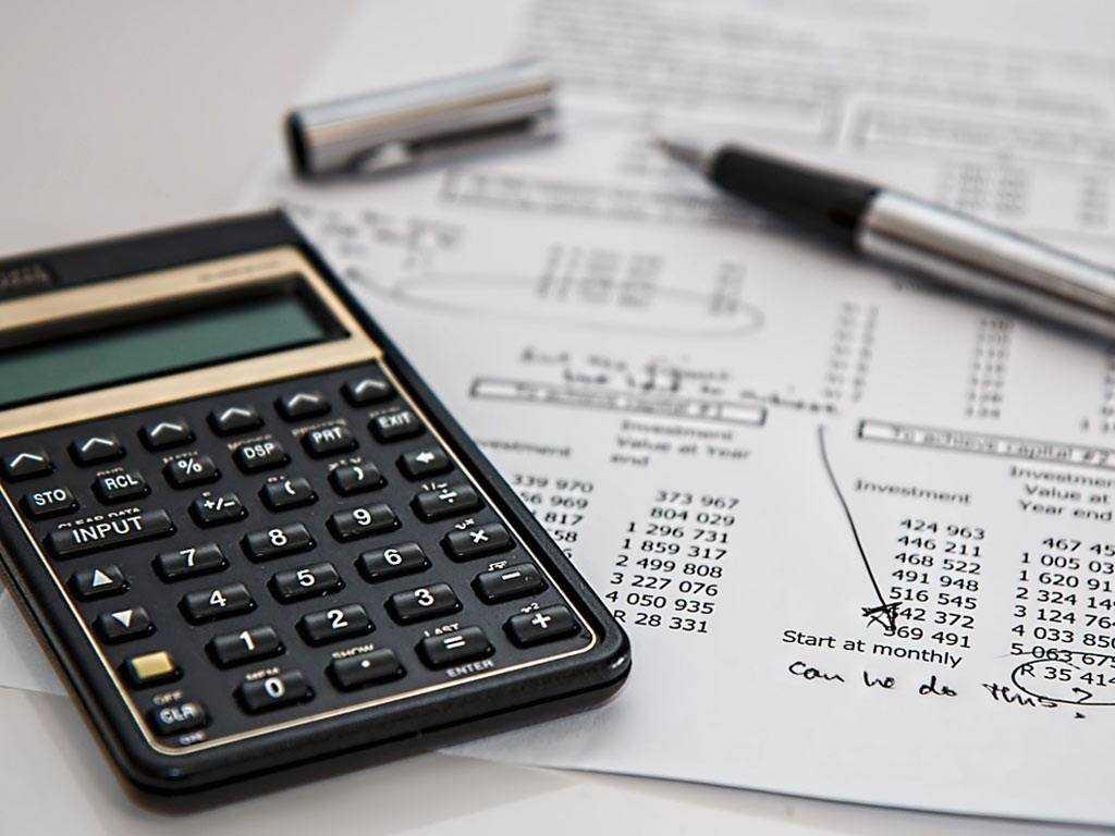 paperwork next to calculator