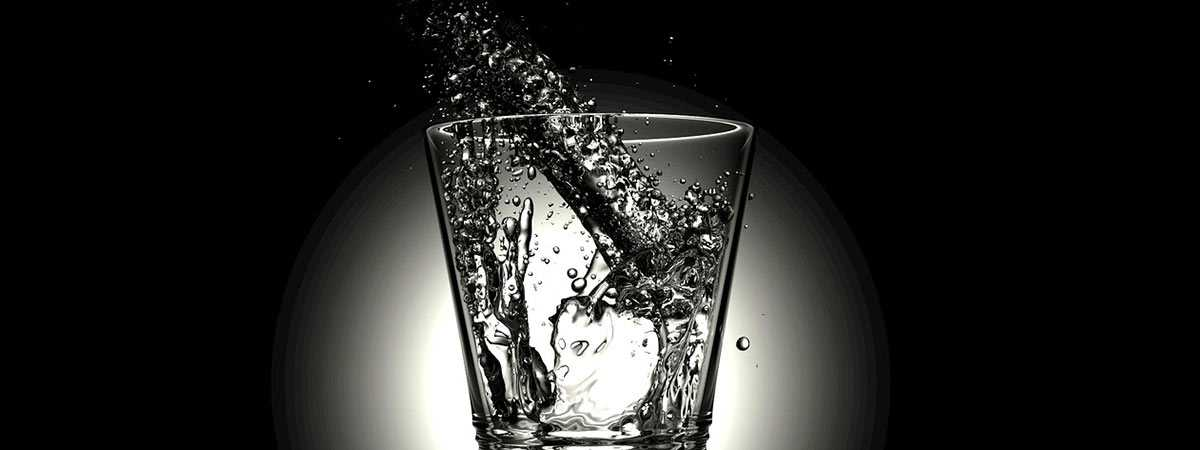 cold water being poured into glass