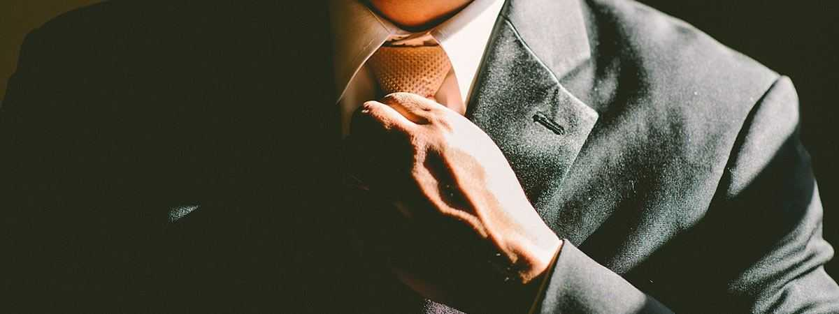 employee straighening tie