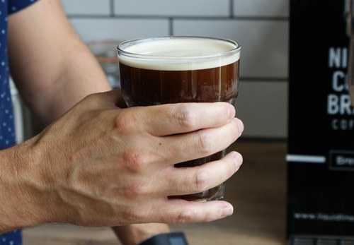 man holding nitro cold brew pint