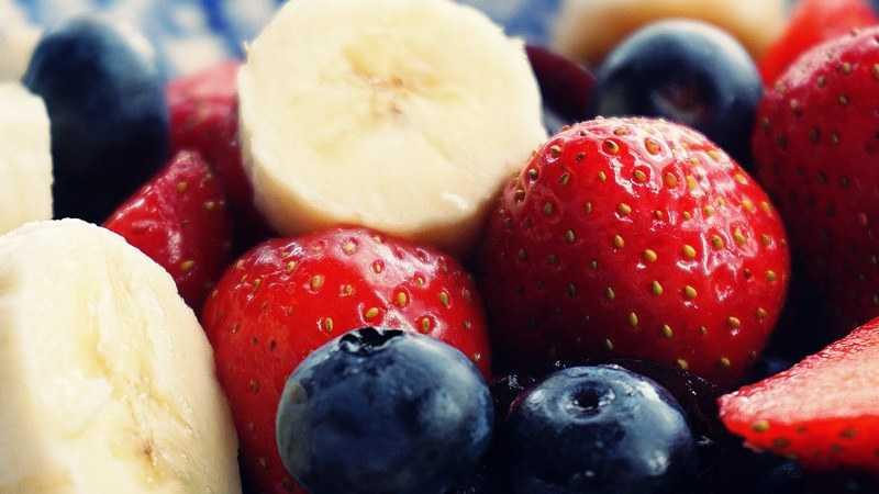 chopped banana strawberries and blueberries