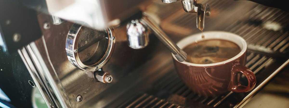 espresso pouring from traditional espresso machine