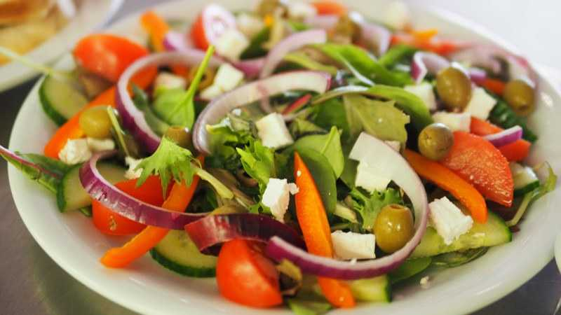 salad with tomatoes onion lettuce cucumber