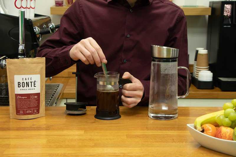 stirring coffee grounds in water
