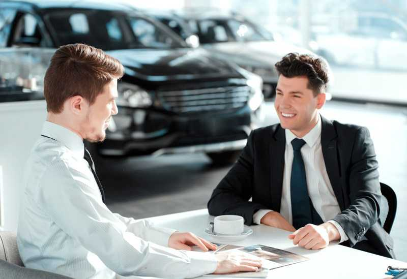 car salesman selling car