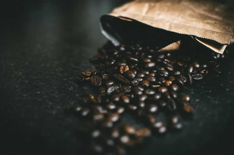 coffee beans spilling from bag