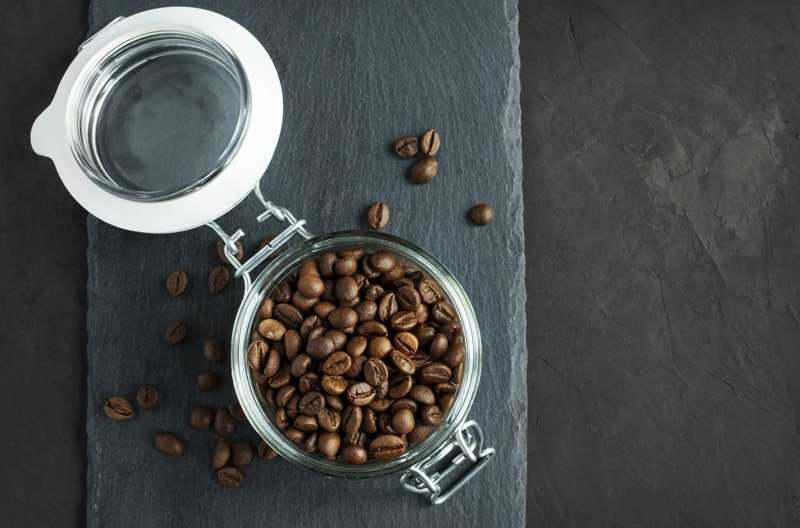 coffee beans stored in a glass jar