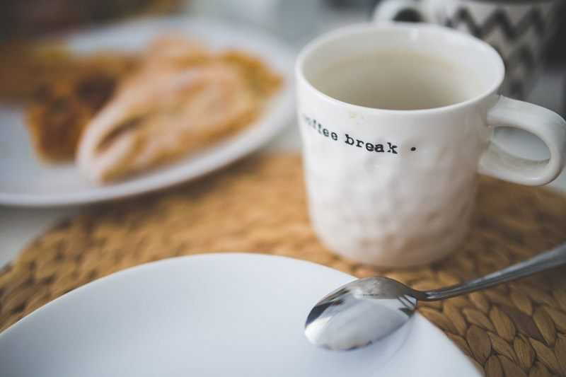 coffee break with white mug and food