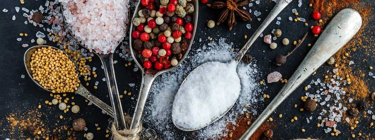 different spices and flavourings on teaspoons