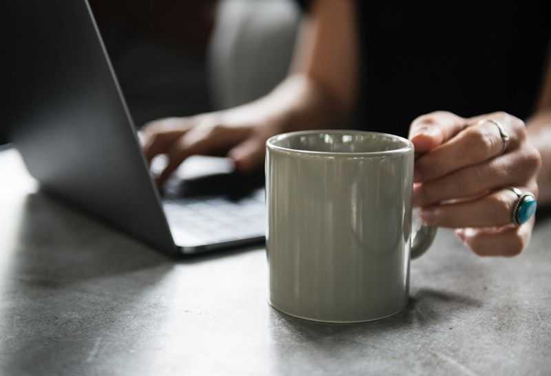 woman at work holding coffee