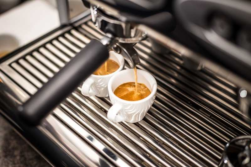 espresso shots pouring from machine