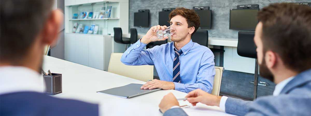 Office workers drinking water