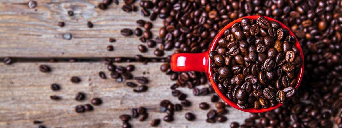 Coffee beans in a red cup