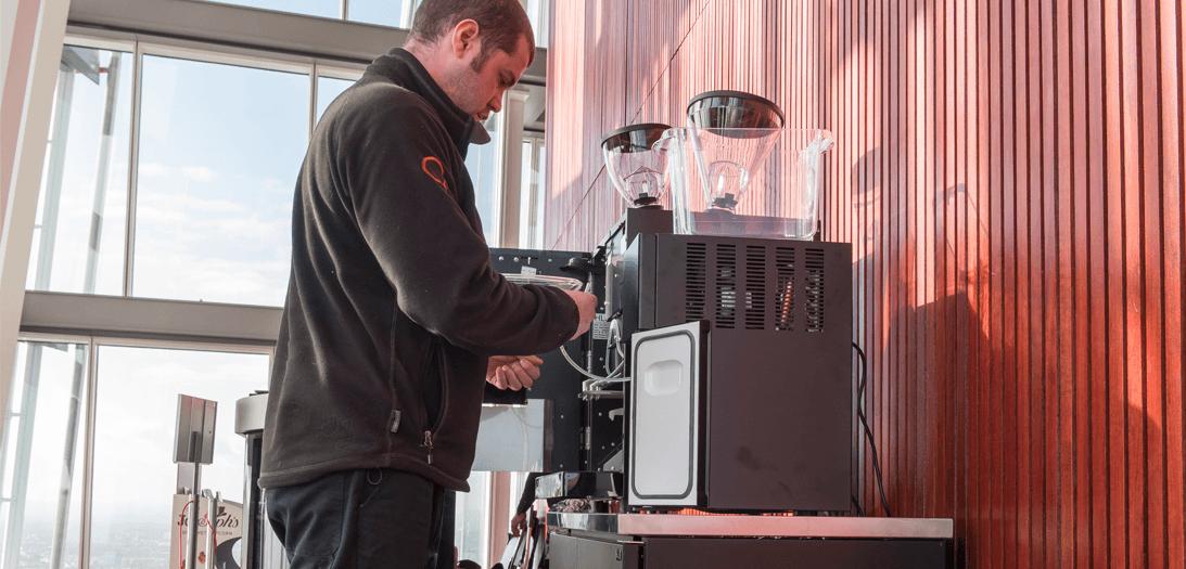 Engineer fixing coffee machine