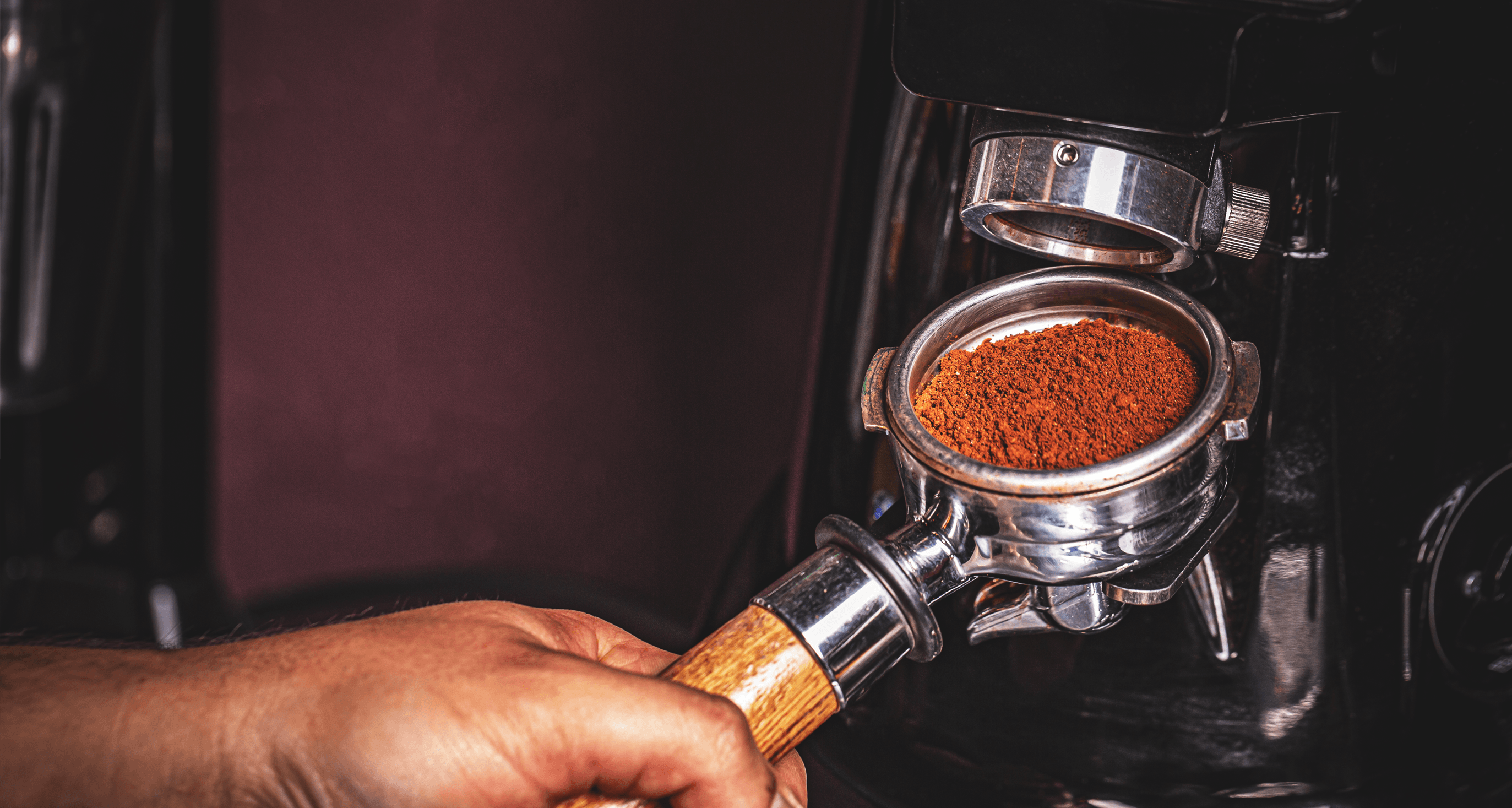 Barista grinding coffee into grouphead