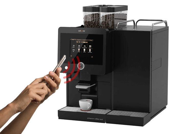 Person operating Schaerer Soul coffee machine from smartphone